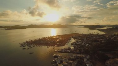 Aerial view Coron city with slums and poor district. Palawan. Busuanga island. Evening time and sunset.