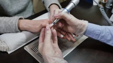Removing old cover. Womans hands at manicure procedures