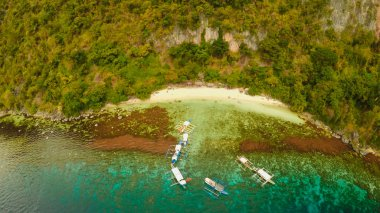 Aerial view Sunset and Atwayan beach with rocks. Travelling tour in Asia: Palawan, Philippines. Fisheye view.