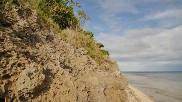Beautiful wild tropical beach near Anda with granite rocks. Bohol Island. Philippines.