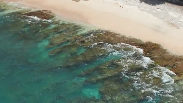Beautiful stone coast of a broken beach on the island of Nusa Penida. Indonesia.