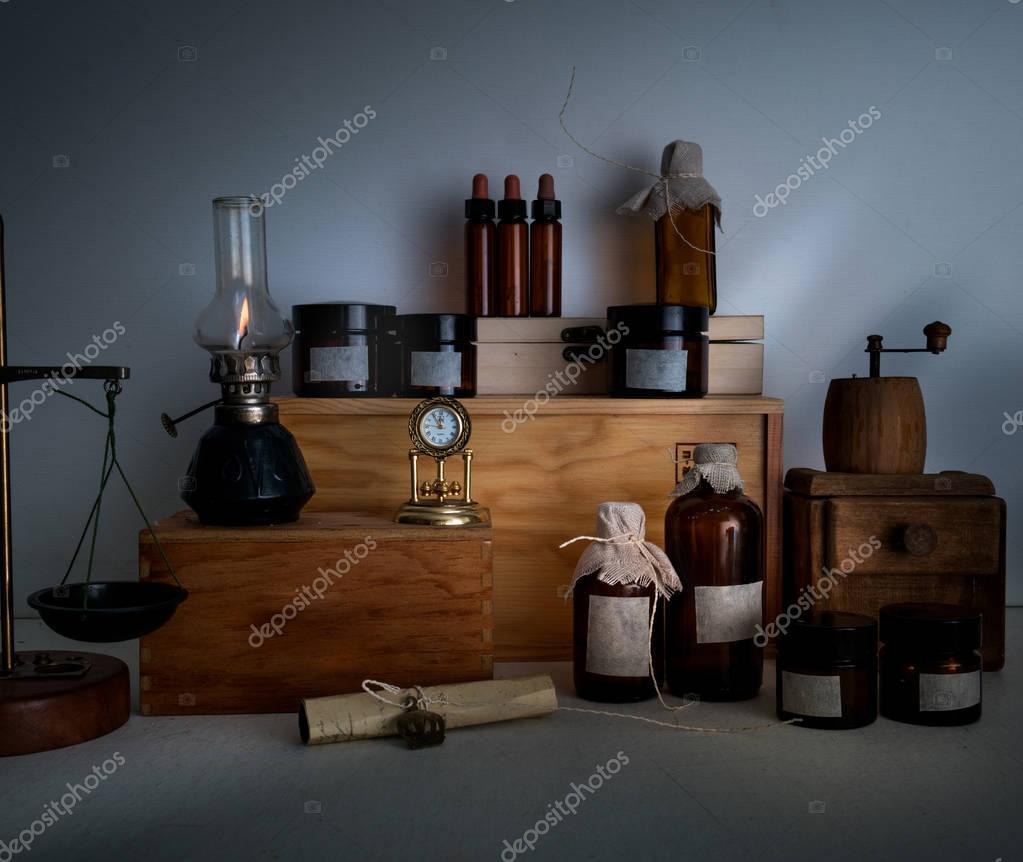 alchemy lab bottles jars scales a kerosene lamp on wooden