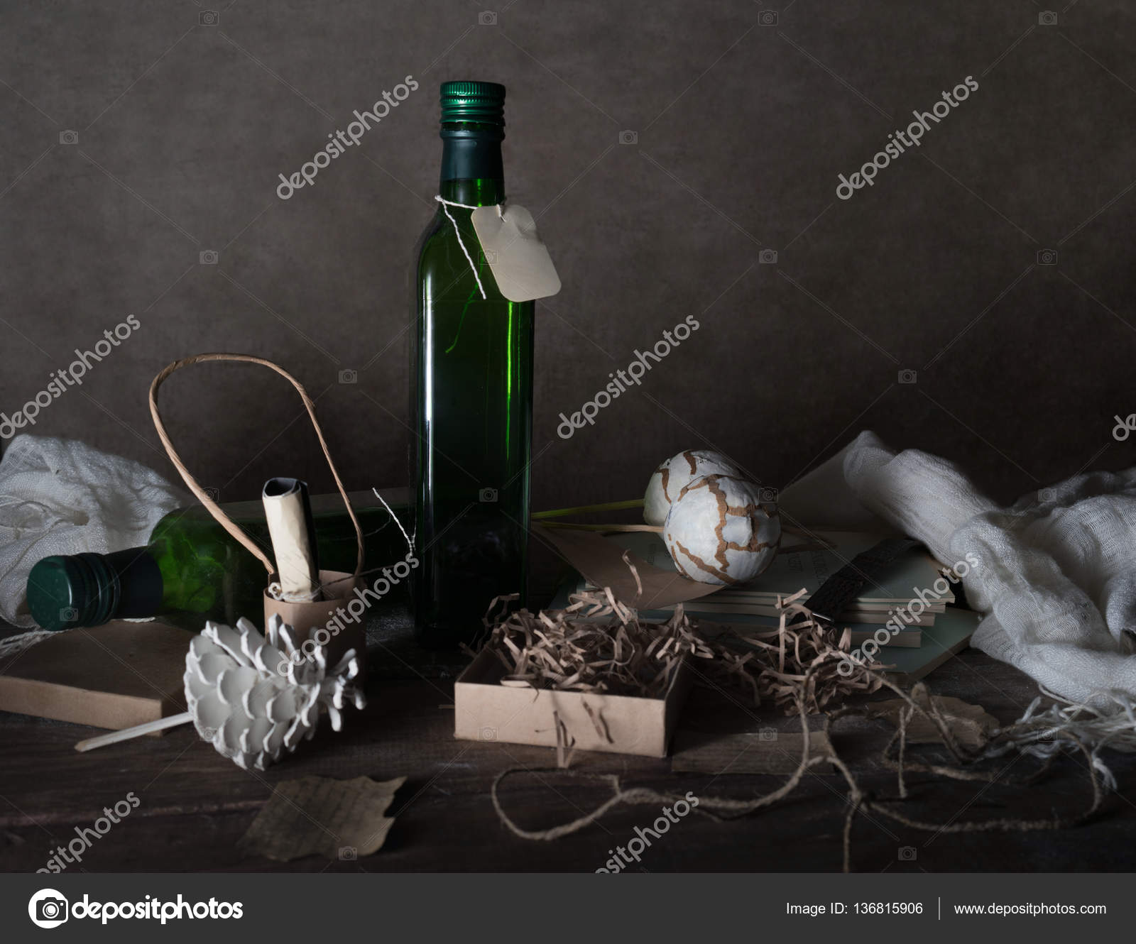 Still Life Vintage Bottle With A Label Boxes Scarf Decor On Wooden Table Dark Background Photo By UGCannel