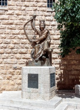 The statue of King David with harp near entrance to his tomb on