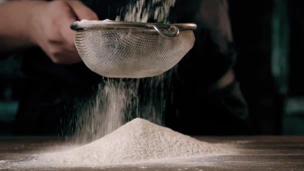 Chiefs Hands Sifting Flour Through a Sieve For Baking