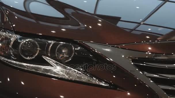 car headlights in modern car showroom