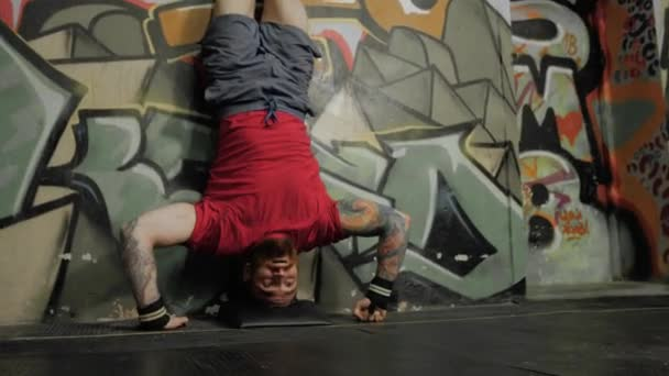 Athlete Power Walking On His Hands And Push Ups Standing Upside Down In Crossfit Gym Near