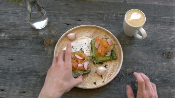Top view of Healthy Sandwich toast with lettuce, ham, cheese, salmon and coffee and tea, on a wooden background
