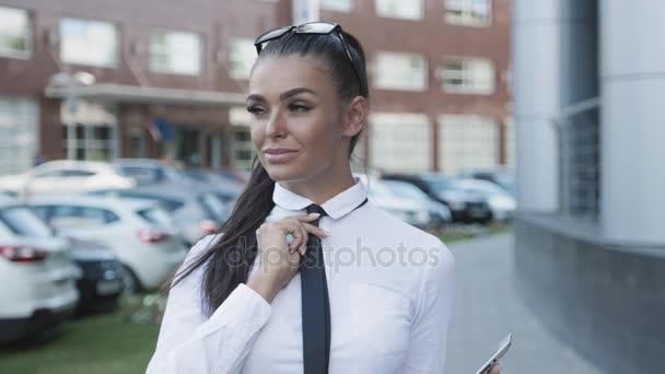 1ab71c21a34 busineswoman portrait in official suit with black tie