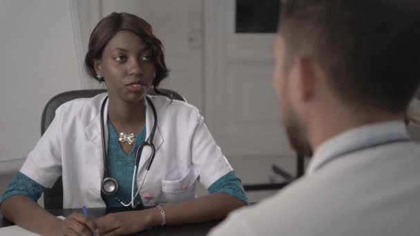 Doctor In White Coat Examining male Patient In Office, blood pressure, african american black nurse in hospital