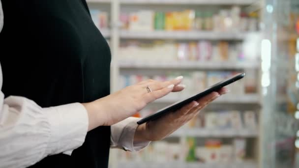 Female pharmacist working in pharmacy with digital tablet and medicine, happy woman drug store, portrait consultant