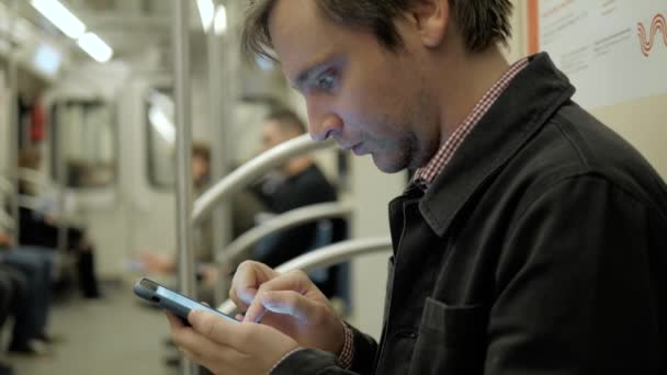 Photo Man voice recognition with smart phone in subway underground railway station train public transportation