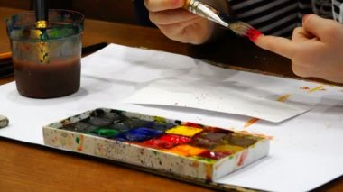 Brushes, colorful paints and watercolors for artistic creation