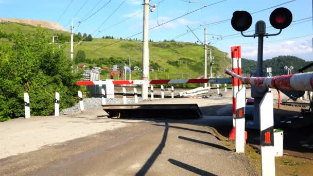 freight train approaching a closed railway crossing