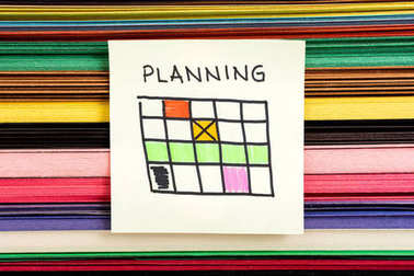 Planning calendar concept illustration with colors paper background