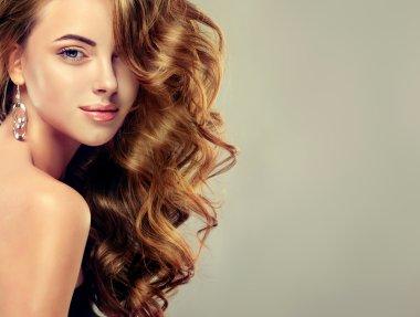 Beautiful girl with long wavy    hair .