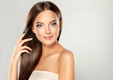 Woman with Clean Fresh Skin  and long straight hair