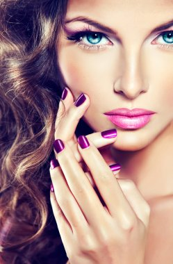 woman with fashion make-up   and purple  manicure