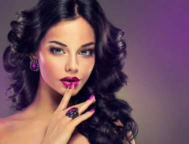 woman with make-up   and purple  manicure