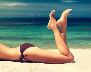 well-groomed feet amid tropical sea .