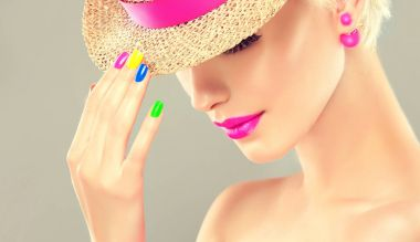 beautiful blond girl with colorful manicure