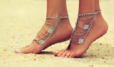 female legs in trendy Boho style