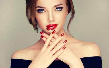 beautiful woman with  red manicure  and lips