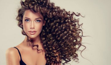 Beautiful girl with long curly hair