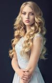Photo Blonde   girl with long  , curly hair