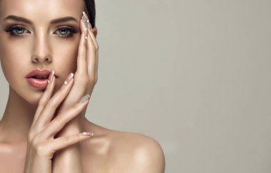 girl with a beige French manicure