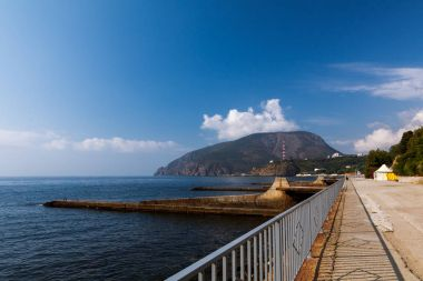 Seaside promenade/ embankment of Partenit village against the backdrop of Ayu-Dag mountain, Crimea