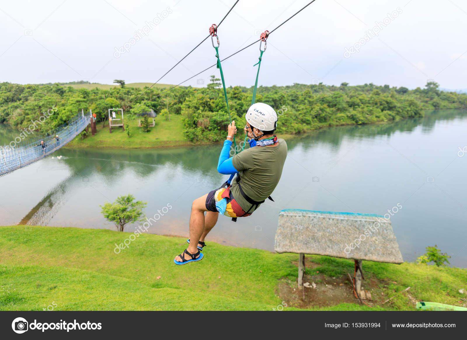 apr 23, 2017 adult man, zip line adventure at mountain lake resort