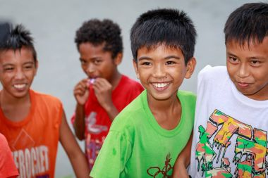 Local Filipino children living near volcano Mount Pinatubo on Au