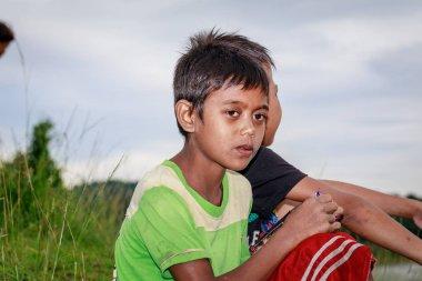 Portrait of Aeta tribe little boy near Mount Pinatubo on Aug 27,
