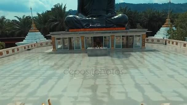 PHANG NGA, THAILAND May 6, 2016: Aerial: Big black monk in Thai temple.