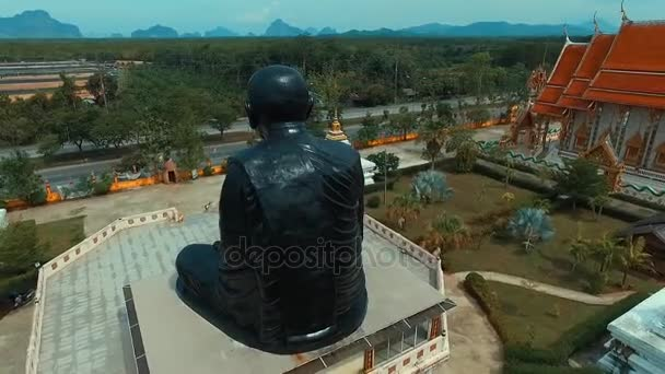 PHANG NGA, THAILAND May 6, 2016: Aerial: Circling around monk statue in Thai temple.