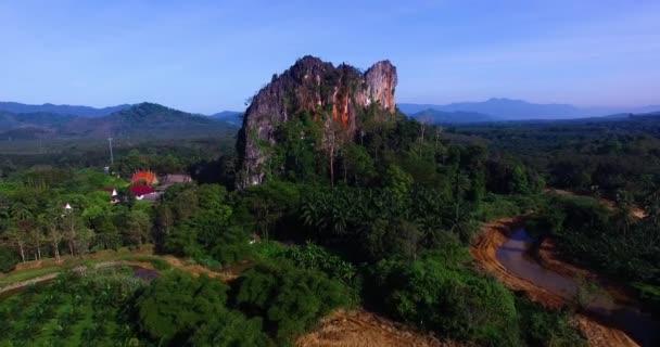 Aerial: Lonely mountain near Wat Suwan Khuha temple.