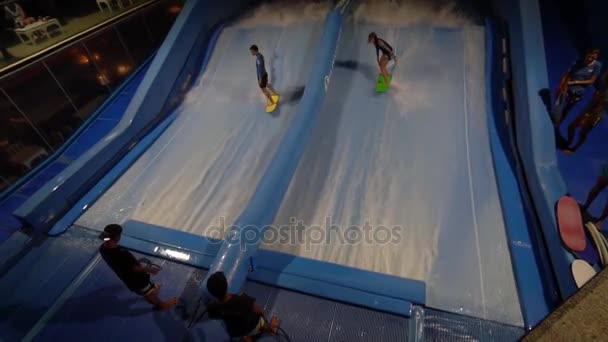 PHUKET, THAILAND May 12, 2017: Two person are flowboarding at surf machine.