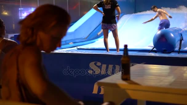 PHUKET, THAILAND May 12, 2017: A girl is sitting in the bar opposite flowriders.