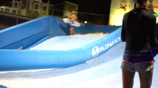 PHUKET, THAILAND May 12, 2017:The flowrider girl is surfing well at surf machine