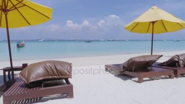 Aerial: Between sun loungers on the beach to the sea. Thailand.