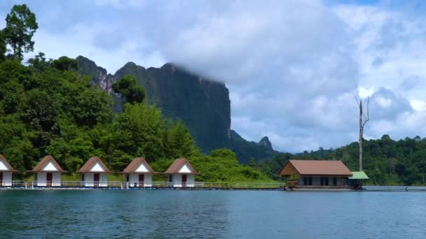 Houses on the lake. A tourist base among tropical forests.