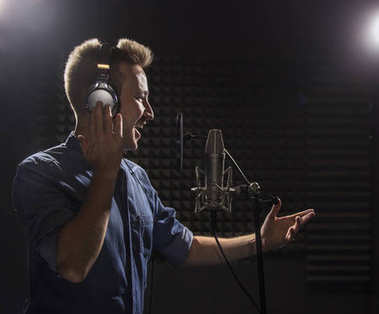 Young Caucasian Singer  Recording Album in the Professional Stud