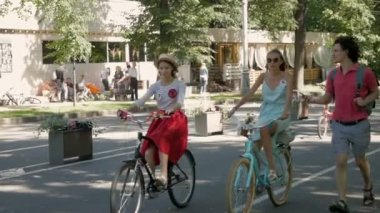Women ride bicycles at Lady on Bike parade