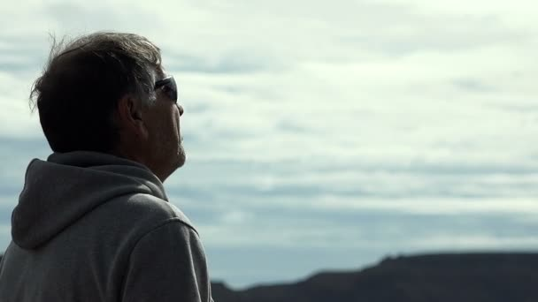 mature man of 50 years observes the horizon after jogging