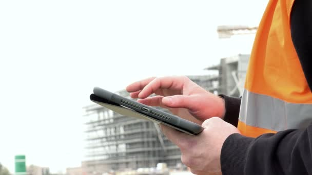 engineer controls the project on tablet