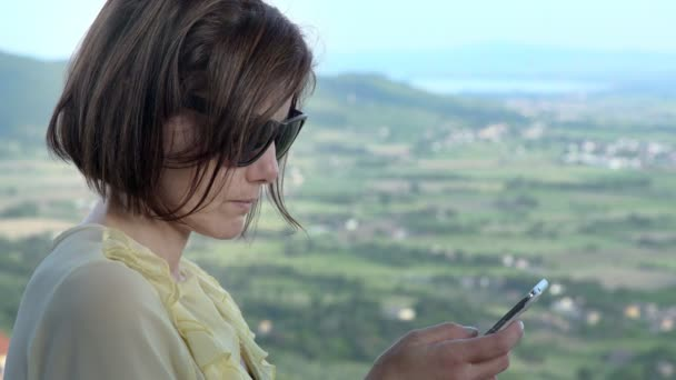 Business woman checking email on mobile
