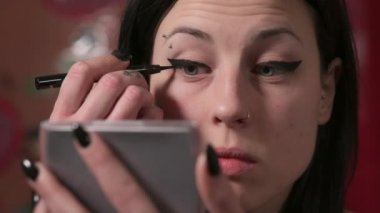 Young woman carefully makeup for a date with man