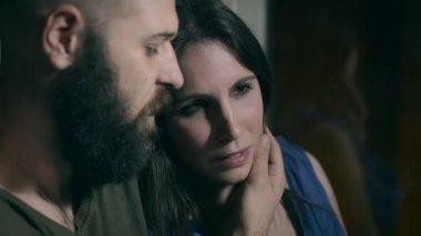 sweet man comforting his sad girlfriend crying desperately