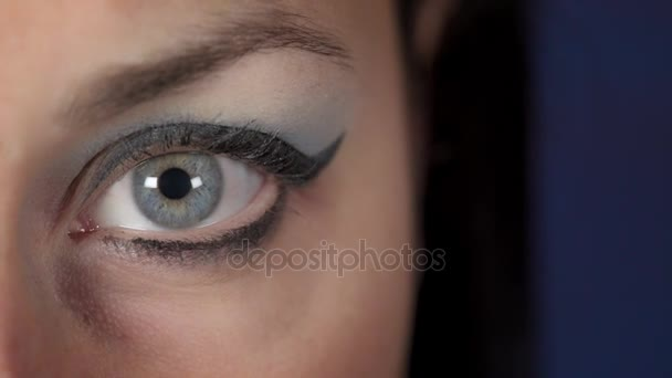 wonderful blue eye of young woman- macro
